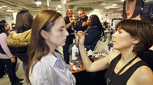 Laura Reynolds, Temptu Artist airbrushing Noelle LoPorto a client at the Makeup Show Los Angeles